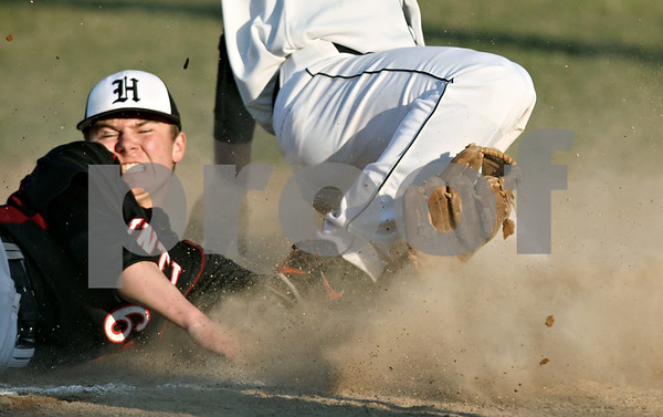 Rob Winner – rwinner@daily-chronicle.com<br /> <br /> Huntley's Tyler Davila (left) is unable to tag out DeKalb's Brian Sisler at third base after a hit by Jake Jouris in the sixth inning on Wednesday, March 30, 2011 in DeKalb, Ill. Huntley defeated DeKalb, 11-8.