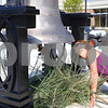 Kyle Bursaw – kbursaw@shawmedia.com<br /> <br /> Carolyn Vaughn peers into the recently installed DeKalb High School bell, which has been with the school since 1912, to see the ringer. The new ringer is made from her father James 'Red' Vaughn's old hammer. It was a surprise to Vaughn, who was at the high school to pick up her son when Athletic Director Dan Jones went to get her after learning about the origin of the ringer on Friday, Aug. 19, 2011.