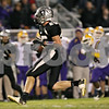 Rob Winner – rwinner@shawmedia.com<br /> <br /> Kaneland's Sean Carter (25) carries the ball after a reception during the second quarter in Maple Park on Friday, Oct. 28, 2011.