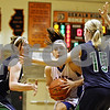 Rob Winner – rwinner@daily-chronicle.com<br /> <br /> Two River Ridge-Scales Mound defenders try to slow Hinckley-Big Rock's Kaitlin Phillips as she drives to the basket during the second quarter of the IHSA Class 1A DeKalb Super-Sectional on Monday February 21, 2011 in DeKalb, Ill. River Ridge-Scales Mound defeated Hinckley-Big Rock, 43-28.