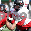 Kyle Bursaw – kbursaw@daily-chronicle.com<br /> <br /> Keith Otis blocks Sean Progar (left) during practice at Huskie Stadium on Saturday, March 26, 2011.