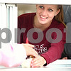 Kyle Bursaw – kbursaw@daily-chronicle.com<br /> <br /> Jenna Johnson, 19, hands an order to a customer through the window at Ollie's Frozen Custard in Sycamore, Ill. on Friday, May 6, 2011.
