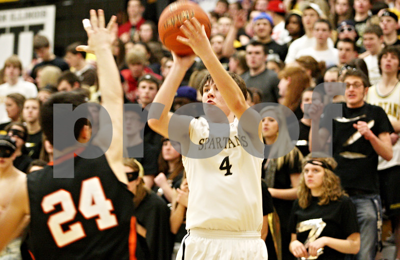 Rob Winner – rwinner@daily-chronicle.com<br /> <br /> Sycamore's Joe Costello (4) sets himself for a field goal during the third quarter in Sycamore, Ill. on Friday, Feb. 25, 2011. DeKalb defeated Sycamore, 56-42.