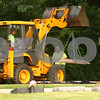 Kyle Bursaw – kbursaw@daily-chronicle.com<br /> <br /> After exhuming the grave of Maria Ridulph, Elmwood cemetery employees Lenny Reynolds Jr. (left, in vehicle) and Josh Goad return the lid back into the grave around 8:30 a.m. on Wednesday, July 27, 2011.