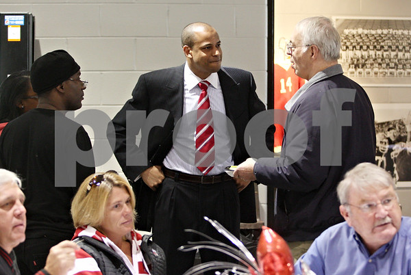Rob Winner – rwinner@daily-chronicle.com<br /> <br /> NIU basketball coach Mark Montgomery meets with guests at the Convocation Center in DeKalb, Ill., on Monday, March 28, 2011.