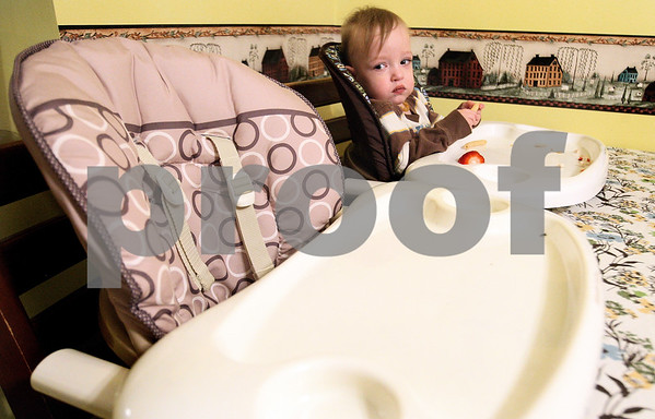 Kyle Bursaw – kbursaw@daily-chronicle.com<br /> <br /> Eighteen-month-old Finn Davis looks to the empty high chair of his identical twin Evan during dinner at the Davis home in Sycamore, Ill. on Tuesday, Feb. 15, 2011. Evan was born with Hypoplastic Left Heart Syndrome and is currently in a hospital near Milwaukee.