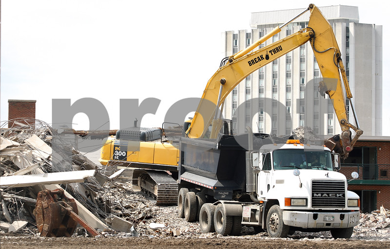 Kyle Bursaw – kbursaw@daily-chronicle.com<br /> <br /> Construction workers tear down University Apartments to make room for a new residence hall on Wednesday, April 13, 2011. The new residence hall is scheduled to open in fall 2012 and is intended for incoming freshmen. It will have 1,000 beds and will be located on Annie Glidden Road north of Lincoln Hall. The buildings will feature cluster-style living arrangements with enhanced privacy, private bedrooms, semi-private bathroomsand a common space that includes a study area, living area and kitchenette. A groundbreaking for the hall is scheduled for noon Monday.