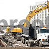 Kyle Bursaw – kbursaw@daily-chronicle.com<br /> <br /> Construction workers tear down University Apartments to make room for a new residence hall on Wednesday, April 13, 2011. The new residence hall is scheduled to open in fall 2012 and is intended for incoming freshmen. It will have 1,000 beds and will be located on Annie Glidden Road north of Lincoln Hall. The buildings will feature cluster-style living arrangements with enhanced privacy, private bedrooms, semi-private bathrooms and a common space that includes a study area, living area and kitchenette. A groundbreaking for the hall is scheduled for noon Monday.