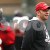 Kyle Bursaw – kbursaw@shawmedia.com<br /> <br /> Northern Illinois University head coach Dave Doeren watches over practice at the DeKalb Recreation Center on Wednesday, Dec. 14, 2011.