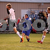 Rob Winner – rwinner@daily-chronicle.com<br /> <br /> Hinckley-Big Rock's Zach Michels (center) takes a shot and scores the Royals' first goal during the first half of the Class 1A Hinckley-Big Rock Sectional championship on Friday night. H-BR defeated Earlville-Leland, 2-1.