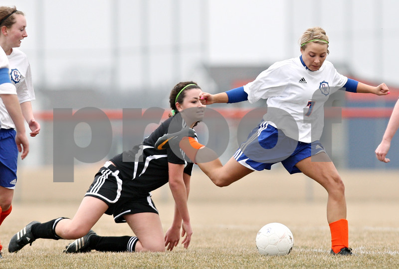 Rob Winner – rwinner@daily-chronicle.com<br /> <br /> Rachael Ellstrom (7) scores Genoa-Kingston's first goal with this shot during the first half. G-K defeated Indian Creek, 5-1.