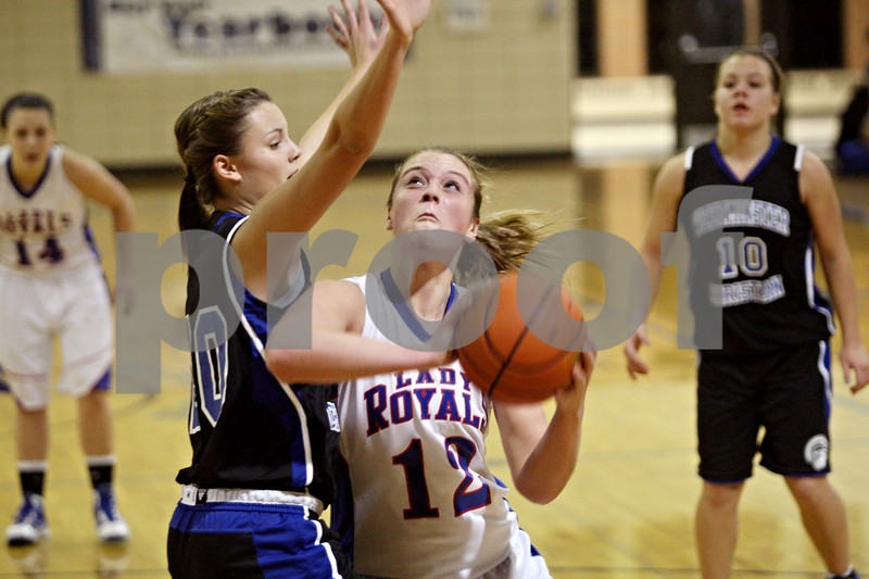 Rob Winner – rwinner@shawmedia.com<br /> <br /> Westminster forward Claire Speweik (left) tries to defend Hinckley-Big Rock's Katie Hollis during the second quarter in Somonauk on Thursday night.