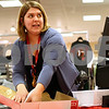 Kyle Bursaw – kbursaw@shawmedia.com<br /> <br /> Rachel Lucek, a customer service associate at JCPenney in DeKalb, removes a gift receipt from the box for a customer making an exchange on Monday, Dec. 26, 2011.