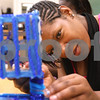 Kyle Bursaw – kbursaw@daily-chronicle.com<br /> <br /> Patricia Yancey, a Guilford High School student from Rockford, puts the finishing touches on her kinetic art piece during a week long STEM outreach in Faraday Hall at NIU in DeKalb, Ill. on Friday, July 1, 2011.