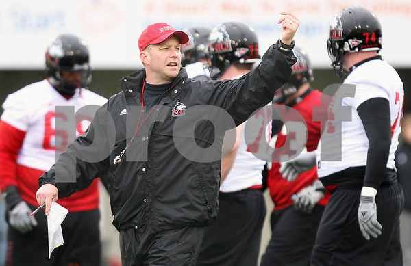 Kyle Bursaw – kbursaw@daily-chronicle.com<br /> <br /> Northern Illinois head coach Dave Doeren signals to his players during practice at Huskie Stadium on Tuesday, March 22, 2011.