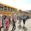Kyle Bursaw – kbursaw@daily-chronicle.com<br /> <br /> As high school students at Sycamore high school load buses, some students from from elementary and middle schools in the district transfer to different buses on Thursday, May 19, 2011.