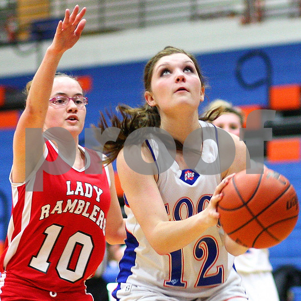 Kyle Bursaw – kbursaw@shawmedia.com<br /> <br /> Genoa-Kingston's Danielle Engel prepares to shoot in front of Mooseheart's Rebecca Stryker during the second quarter of their game in Genoa, Ill. on Wednesday, Dec. 14, 2011.