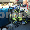 Kyle Bursaw – kbursaw@shawmedia.com<br /> <br /> DeKalb Firefighters remove a woman from the passenger seat of a vehicle that flipped on its side in a collision on the 200 block of East Lincoln Highway on Monday, Dec. 12, 2011.