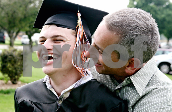 Rob Winner – rwinner@daily-chronicle.com<br /> <br /> After the Sandwich Community High School commencement ceremony, Andrew Mason is embraced by his father, Rick Mason, on Sunday afternoon in Sandwich.
