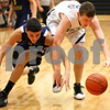 Kyle Bursaw – kbursaw@shawmedia.com<br /> <br /> Sycamore center Scott Nelson and Sterling forward Chris Fritsch chase a loose ball in the first quarter of their match in the Chuck Dayton Holiday Tournament at DeKalb High School on Friday, Dec. 23, 2011. Sterling defeated Sycamore 61-41.