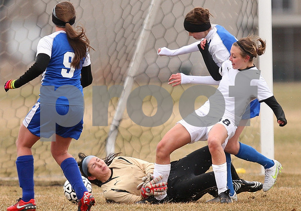 Kyle Bursaw – kbursaw@daily-chronicle.com<br /> <br /> Sycamore goalie Olyvia Rand and Sarah Papini can't stop St. Francis from scoring the only goal of the game in the first half at Sycamore high school on Tuesday, March 22, 2011.