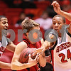 Kyle Bursaw – kbursaw@daily-chronicle.com<br /> <br /> Tony Nixon (left) and Jeremy Landers (right) make a play for the ball held by Ball State's Randy Davis during the first half of game between the Northern Illinois Huskies and the Ball State Cardinals. The Cardinals defeated the Huskies 75-70 on Saturday, Jan. 8, 2011.