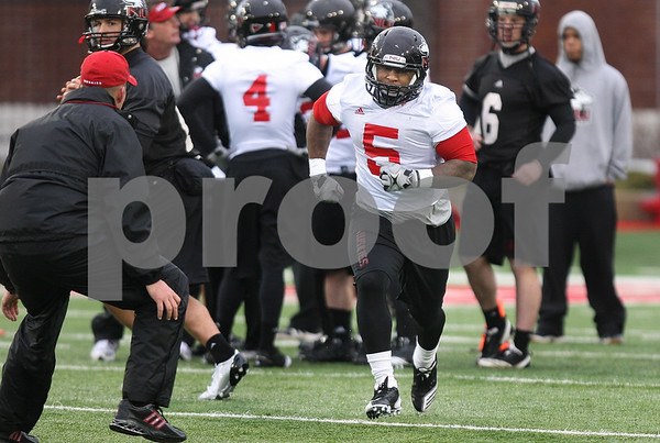 Kyle Bursaw – kbursaw@daily-chronicle.com<br /> <br /> Jamal Womble (5) takes off on a route out of the backfield during practice at Huskie Stadium on Tuesday, March 22, 2011.