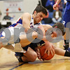 Rob Winner – rwinner@shawmedia.com<br /> <br /> Genoa-Kingston's Sal Lopez (left) and Westminster Christian's Sam Carani battle for possession during the first quarter in Genoa, Ill. on Saturday, Dec. 10, 2011.