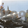 Kyle Bursaw – kbursaw@shawmedia.com<br /> <br /> A firefighter puts out the remains of David Yakey's corn crib at 3508 Baseline Rd south of Kirkland, Ill on Thursday, Oct. 6, 2011. According to Lt. Carl Bruder of the Kirkland Fire Department, a change in wind direction carried the flames of a rubbish fire over to the corn crib around 5:05 p.m. Bruder said an early estimate of the damages was $20,000.