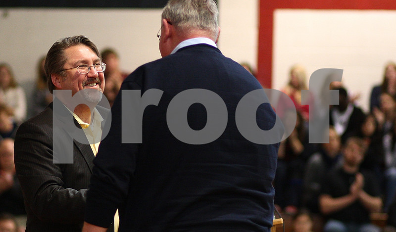 Kyle Bursaw – kbursaw@shawmedia.com<br /> <br /> Marc Miller (left), the director of the Illinois Department of Natural Resources, recognizes the work of Shabbona Lake State Park Superintendent Kerry Novak (right) during a ceremony celebrating the park at Indian Creek High School on Monday, Dec. 12, 2011.