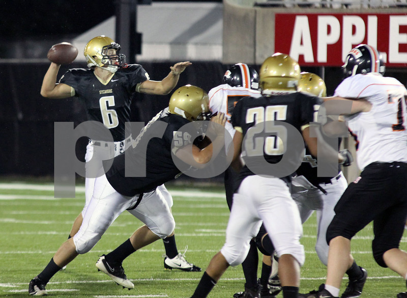 Wendy Kemp - For The Daily Chronicle<br /> Sycamore quarterback Ryan Bartels throws a pass during Friday's game against DeKalb at Huskie Stadium.<br /> DeKalb 9/9/11