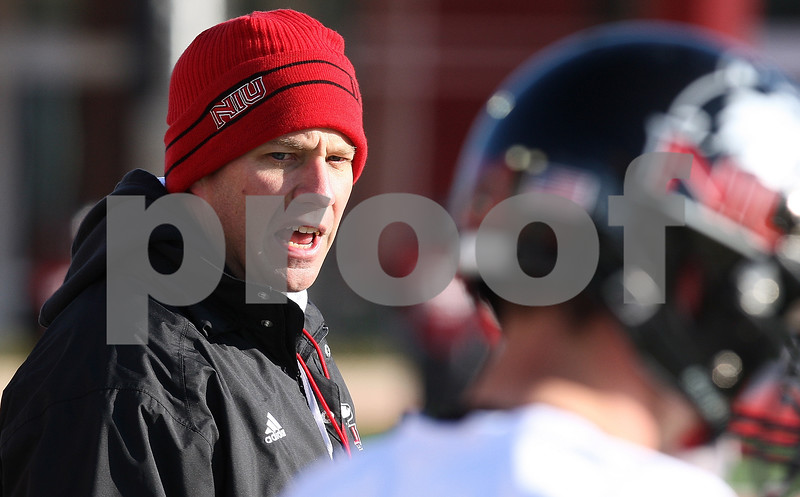 Kyle Bursaw – kbursaw@daily-chronicle.com<br /> <br /> Head coach Dave Doeren leads a drill at practice at Huskie Stadium on Thursday, March 24, 2011.
