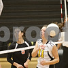 Rob Winner – rwinner@shawmedia.com<br /> <br /> Sycamore's Ellyn Heegaard (11) can only watch after a Sycamore kill attempt is rejected by DeKalb's Courtney Bemis (13) during the second game in DeKalb on Wednesday, Oct. 5, 2011. DeKalb defeated Sycamore, 28-26 and 25-19.