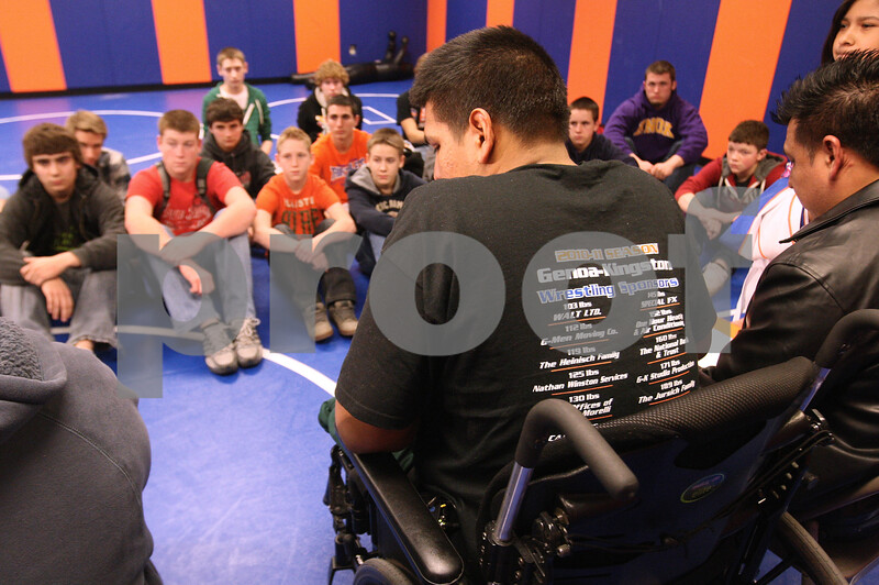 """Kyle Bursaw – kbursaw@daily-chronicle.com<br /> <br /> Belvidere North wrestler Heriberto """"Eddie"""" Avila sports a Genoa-Kingston wrestling shirt while he and his family visited the team to talk with them about his accident and reassure them about how he is doing. Avila maintains a positive attitude and high hopes for his future despite losing part of his left leg after a wrestling accident in January.<br /> <br /> Wednesday, Feb. 23, 2011."""