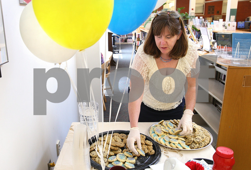 Kyle Bursaw – kbursaw@daily-chronicle.com<br /> <br /> Sarah Tobias, director of the Sycamore Public Library, refills the refreshments available at the library for the library board's 120th anniversary on Wednesday, May 11, 2011.