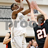 Rob Winner – rwinner@shawmedia.com<br /> <br /> Kaneland's Marcel Neil (23) tries for a field goal during the first quarter in Maple Park, Ill., on Friday, Dec. 16, 2011. Kaneland defeated DeKalb, 58-46.