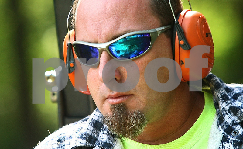 Kyle Bursaw – kbursaw@daily-chronicle.com<br /> <br /> Mike Dean, of the DeKalb Parks Department, wears protection on his eyes and ears while mowing Lions Park on Thursday, July 14, 2011.