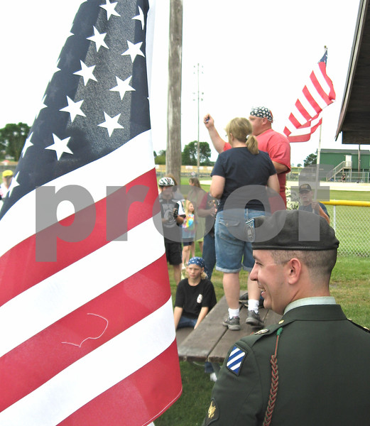 Army Specialist Scott Maratto looks on as his mother, Brenda Maratto-Kader, and Troy Walker of Warrior Watch speak Sunday afternoon during a ceremony celebrating Maratto's return home.