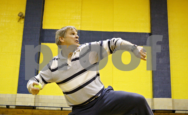 Rob Winner – rwinner@shawmedia.com<br /> <br /> Physical education instructor Dave Cox explains how to throw a ball during a first grade gym class at Hiawatha Elementary School in Kirkland on Thursday, Nov. 3, 2011. The Kirkland school has for the second time in three years been named state champion in its division in the President's Council of Physical Fitness competition.