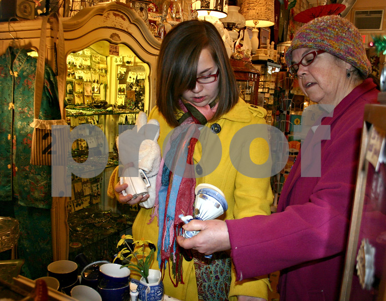 Emily Silver (left) does some last-minute Christmas shopping with her mom, Eileen Silver, at Cracker Jax in DeKalb Friday. Between the two of them, they were hoping to cross eight people off their Christmas lists by the end of the day.<br /> <br /> By Nicole Weskerna - nweskerna@shawmedia.com