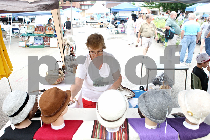 Rob Winner – rwinner@daily-chronicle.com<br /> <br /> Plato Center resident Jill Muirhead displays her alpaca felted hats in the open air market during the Summer Farm Fest in downtown Genoa on Saturday.