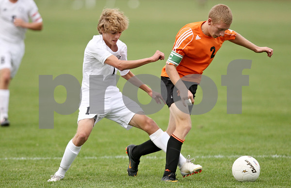 Rob Winner – rwinner@shawmedia.com<br /> <br /> Kaneland's Tyler Siebert (1) and DeKalb's Sammy Lake try to control a ball during the first half in Maple Park on Thursday, Sept. 29, 2011.