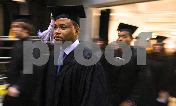 Kyle Bursaw – kbursaw@daily-chronicle.com<br /> <br /> Graduating NIU students enter the floor of the Convocation Center for the 9 a.m. ceremony in DeKalb, Ill. on Saturday, May 14, 2011.
