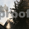Rob Winner – rwinner@shawmedia.com<br /> <br /> Fire fighters use a ladder to spray flames on the roof of a house located on the 200 block of South Genoa Street in Genoa on Wednesday afternoon.
