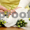 Rob Winner – rwinner@daily-chronicle.com<br /> <br /> Volunteer Sue Pfund, of Sycamore, ties together bunches of daffodil flowers during the American Cancer Society Daffodil Days program at the Kishwaukee Community Hospital in DeKalb on Monday morning.