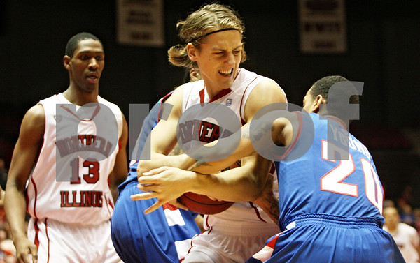 Rob Winner – rwinner@shawmedia.com<br /> <br /> Northern Illinois' Aksel Bolin (left) and DePaul guard Brandon Young (20) struggle over a ball during the firs half in DeKalb, Ill., on Wednesday, Dec. 14, 2011.