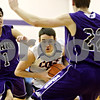 Rob Winner – rwinner@daily-chronicle.com<br /> <br /> Genoa Kingston's Bret Lucca (center) tries to drive two Plano defenders during the first quarter of the IHSA Class 2A Plano Regional Semifinal in Plano, Ill., on Wednesday, February 23, 2011.