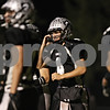 Rob Winner – rwinner@shawmedia.com<br /> <br /> Kaneland quarterback Drew David (4) cracks a smile after carrying a ball in for a touchdown during the first quarter in Maple Park on Friday, Oct. 28, 2011.