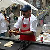 Daniel Torres warms tortillas Sunday at Taxco Restaurant's Cinco de Mayo festival in downtown Sycamore. The event, featuring music, games and Mexican food, drew a large crowd Sunday.<br /> <br /> Caitlin Mullen - cmullen@daily-chronicle.com