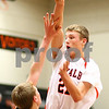 Kyle Bursaw – kbursaw@shawmedia.com<br /> <br /> DeKalb forward James Robinson leaps over Winnebago's Dalton Menke to pass as DeKalb tries to run clock in the fourth quarter of their 46-36 victory in DeKalb, Ill. on Thursday, Dec. 22, 2011.